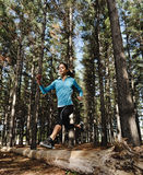 Jumping trail runner Royalty Free Stock Photos
