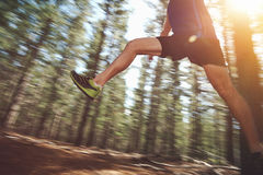 Jumping trail runner Stock Image
