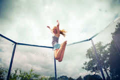 Jumping on a trampoline Royalty Free Stock Photo