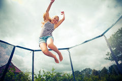 Jumping on a trampoline Stock Image
