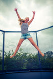 Jumping on a trampoline Stock Photography