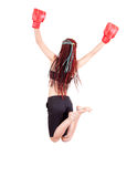 Jumping trendy teenage girl with boxing gloves Royalty Free Stock Photos