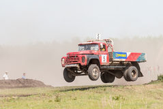 Jumping truck on racing line Stock Photo