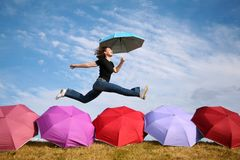 Jumping with umbrella Royalty Free Stock Image