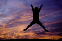 Jumping up at sunset. Royalty Free Stock Image