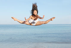 Jumping on vacation. Happy young woman jumping on summer vacation Royalty Free Stock Photos