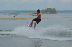 Jumping Wakeboarder Letting Go Of the Tow Rope Stock Photo