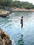 Jumping in water. Young man jumps in the sea water Royalty Free Stock Photos