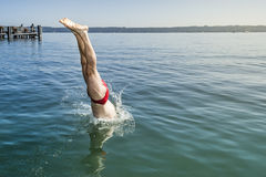 Jumping into the water Royalty Free Stock Photos