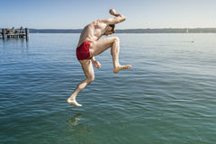 Jumping into the water Royalty Free Stock Photography