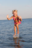 Jumping in the water child Royalty Free Stock Photography