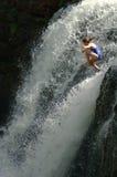 Jumping waterfall. Woman jumping waterfall Stock Photos
