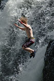 Jumping waterfall. Man jumping waterfall stock images