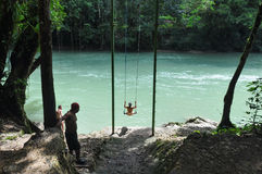 Jumping into the waters of Semuc Champey, Guatemala Stock Photos