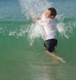 Jumping waves. A boy jumping sea waves Royalty Free Stock Image