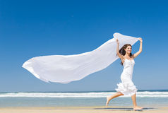 Jumping with a white scarf Royalty Free Stock Photo