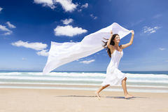 Jumping with a white scarf Royalty Free Stock Image