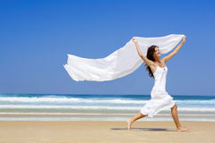 Jumping with a white scarf Royalty Free Stock Photography