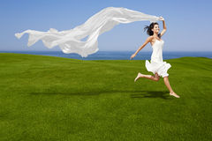 Jumping with a white tissue Royalty Free Stock Image