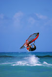 Jumping windsurfer. In rough sea Stock Images