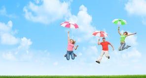 Free Jumping With Umbrellas Stock Photos - 17880353