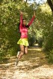 Jumping woman Stock Photo