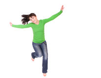 Jumping woman. Active woman jumping over white background Stock Photography