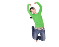 Jumping woman. Active woman jumping over white background Royalty Free Stock Photography