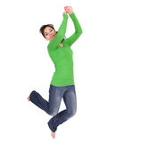 Jumping woman. Active woman jumping over white background Stock Photo