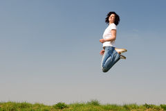 Jumping woman Stock Photo