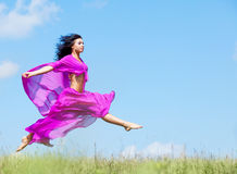Jumping woman Stock Photos
