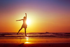 Jumping woman. Woman jumping on the beach Royalty Free Stock Images