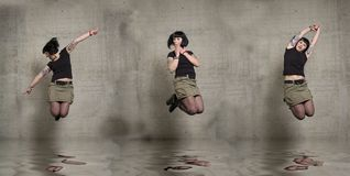 Jumping woman Stock Images
