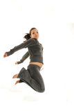 Jumping woman. Active woman jumping on white background Royalty Free Stock Photos