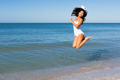 Jumping woman. At the beach stock images