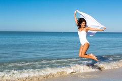Jumping woman. Woman jumping on the beach royalty free stock photography