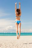 Jumping woman on the beach. Bright picture of jumping woman on the beach Royalty Free Stock Image
