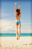Jumping woman on the beach. Bright picture of jumping woman on the beach Stock Image