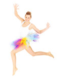 Jumping woman in a colourful skirt Stock Image