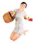 Jumping woman with fruit Stock Photo