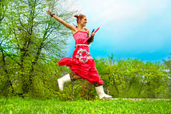 Jumping woman on green grass Stock Photos