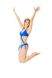 Jumping woman with hands up Royalty Free Stock Photography