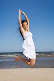 Jumping woman. Happy woman jumping on the beach Stock Image