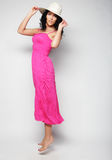 Jumping woman. Happy emotional girl wearing pink dress. Stock Images