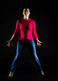 Jumping woman. Happy jumping  smiling young woman with fit body Royalty Free Stock Image