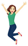 Jumping woman. Happy surprised woman in jeans jumping isolated Stock Photos