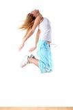 Jumping woman modern ballet dancer. In ballroom royalty free stock photo