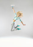 Jumping woman with a paint roller Stock Photo