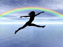 Jumping woman in the rainbow Royalty Free Stock Photo