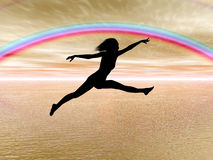 Jumping woman in the rainbow Royalty Free Stock Images